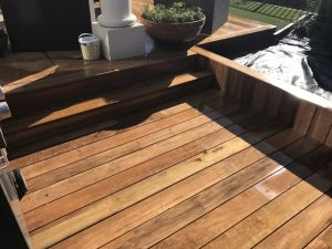 Outdoor living area with decking extension